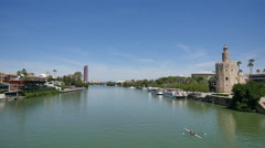 Seville Torre del Oro from bridge over Guadalquivir River Stock Footage