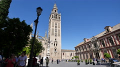 Seville Giralda Tower with street light and tourists Stock Footage