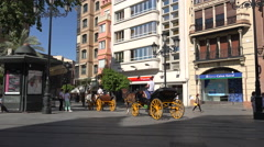 Spain Seville street with horses and buggies Stock Footage