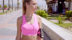 Gorgeous blond wearing pink shorts and top Stock Footage