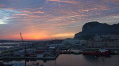 Gibraltar Rock sun peeping up Stock Footage