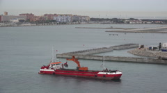 Gibraltar red ship with dredge Stock Footage