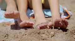Bare feet of two young women in beach sand Stock Footage
