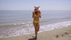 Happy gorgeous sexy woman in a bikini - stock footage
