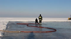 Firefighters are making ice rink on the frozen Vistula Lagoon Stock Footage