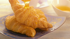breakfast with croissant, cup of coffee and honey - stock footage