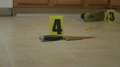 Slow Dolly of Bloody Knife Crime Scene Stock Footage