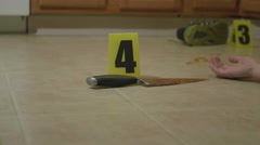 Body on Floor at Crime Scene in Kitchen Stock Footage