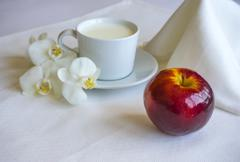 Breakfast With Milk And Red Apple Stock Photos