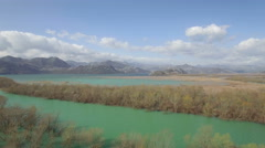 Aerial view of Moraca river which flows into beauty big Skadar lake Stock Footage