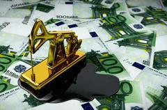 Gold Pumpjack And Spilled Oil On Euros Stock Illustration