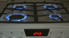 Four gas burners burn blue flame on a gas stove Stock Footage