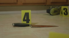 Bloody Knife on Kitchen Floor at Crime Scene Stock Footage