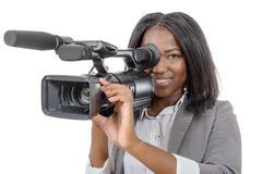 young African American women with professional video camera - stock photo
