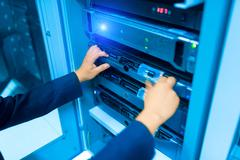 Man fix server network in data center room Kuvituskuvat