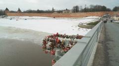 Closed wedding locks on pipes on the bridge Stock Footage