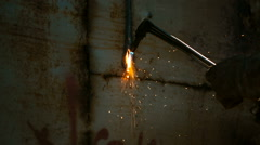 Worker cutting metal with acetylene torch Stock Footage