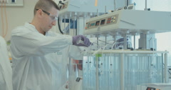 Chemical experiment in a large lab Stock Footage
