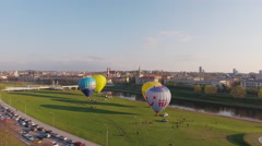 Lithuania, Vilnius cityscape on sunset, air baloons, aerial view. Stock Footage
