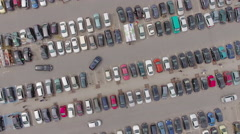 Cars on parking lot of typical big shopping mall, iconic aerial view. Stock Footage