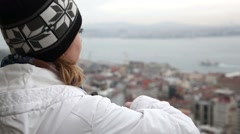 Beautiful woman looks at the Bosphorus Stock Footage