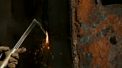 Worker cutting metal with acetylene torch - stock footage