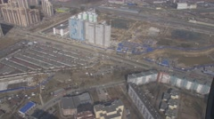 Aerial view from flying helicopter. Camera inside. Landscape city. Construction - stock footage