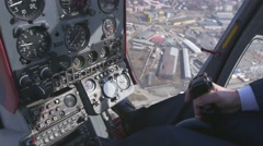 View at control system, pilot hold lever of helicopter. Camera inside. Above Stock Footage