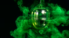 A tea egg with fluorescein in water. Stock Footage
