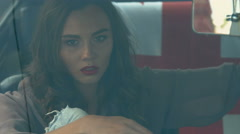 Seductive woman with red lipstick posing in the cabin car for the magazine Stock Footage