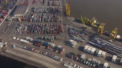 Aerial view from helicopter fly above colorful cargo containers in seaport - stock footage