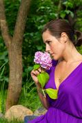 Beautiful young brunet woman outdoors - stock photo