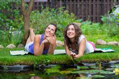 Two beautiful young brunet woman outdoors Stock Photos