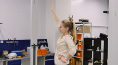 Young woman come to make a 3D scan of her own in research lab Stock Footage