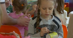 Kids Engaged in Art Little Girls Are Painting Their Paper Toys Yellow Giraffes Stock Footage