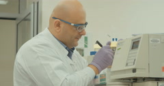 Scientist operating spectrometers in a lab Stock Footage