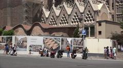 Spain Barcelona Sagrada Familia pedestrians and posters Stock Footage