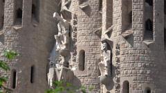 Spain Barcelona Sagrada Familia two saints on facade Stock Footage