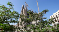 Spain Barcelona Sagrada Familia with tree in front Stock Footage