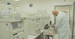 Scientist operating a mass spectrometer Stock Footage