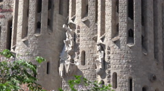 Spain Barcelona Sagrada Familia zooms on two carved figures Stock Footage