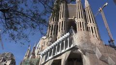 Spain Barcelona Sagrada Familia zooms to St Bartholomew figure Stock Footage