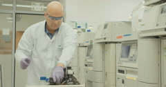 Scientist working with mass spectrometer analyzing chemicals Stock Footage
