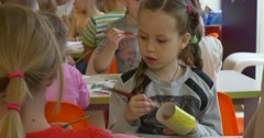 Kids Little Girls Are Painting Their Paper Toys Yellow Giraffes People Engaged Stock Footage