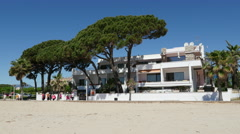 Spain Cambrils view of a beachside inn with pine trees Stock Footage