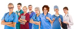 Smiley medical team of eight people Stock Photos