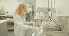 Scientist working in a research lab with robotic machine Stock Footage