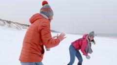 Walk on the beach snow fight Stock Footage