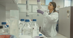 Scientist working with test tubes in a research laboratory Stock Footage
