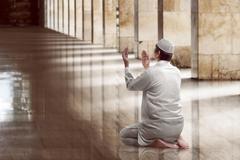 Religious muslim man praying Stock Photos